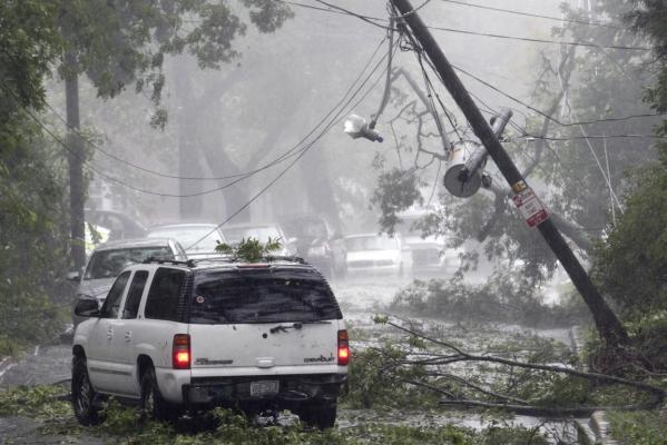 A vehicle avoids a downed pole as Hurricane Irene hits Greenville, North Carolina, US.