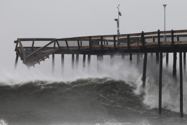 Waves break along the pier which was damaged during Hurricane Irene, in Ocean City, Maryland.