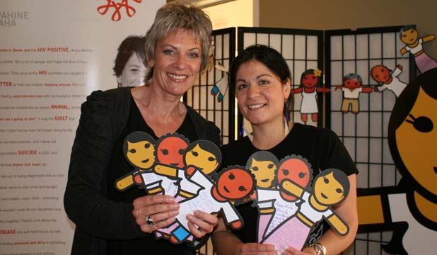 WISE WOMEN: Jane Bruning, left, from Positive Women and Sarah Davies from YWCA Aotearoa show off some of the paper dolls signed in Whangarei to campaign for more female condoms.