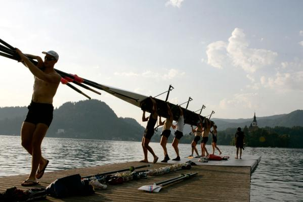 A men's eight pack up after a training session on Lake Bled.