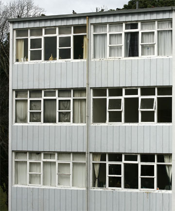 ALONE TO THE END: Curtains are drawn in the unit, left, where Mr Clarke lay dead for months. Many of the flats around it are empty and the block is due to be demolished.