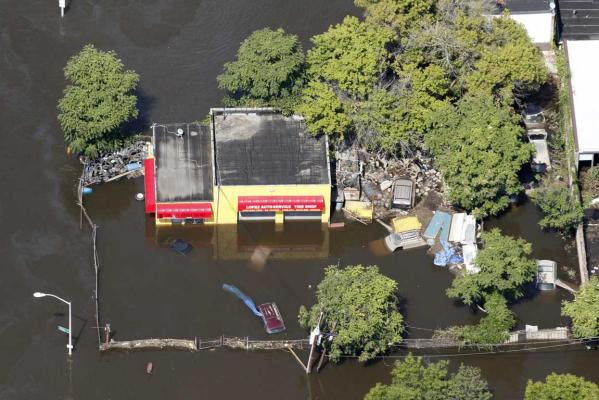 Floodwaters from the Passaic River engulf a service station after Hurricane Irene in Paterson, New Jersey.