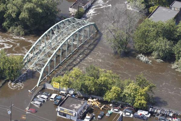 Floodwaters from the Passaic River engulf a bridge days after Hurricane Irene in Paterson, New Jersey.