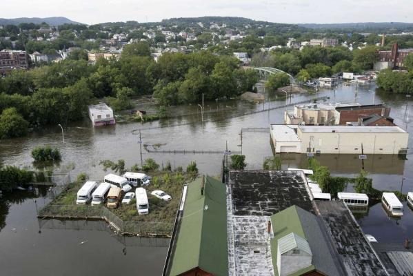 The swollen Passaic River floods River Road in Paterson, New Jersey.
