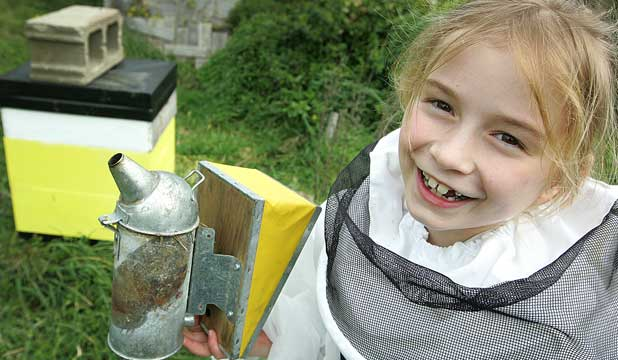 FEEL THE BUZZ: Young beekeeper Quinn Straker says,