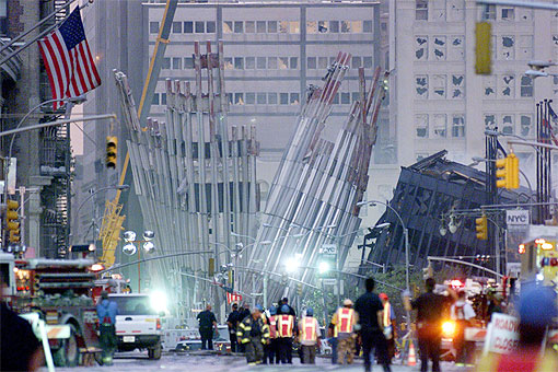 Workers walk near the wreckage of the World Trade Center.