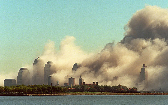 The New York skyline is filled with dust after the hijacked airliners crashed into the World Trade Center towers.