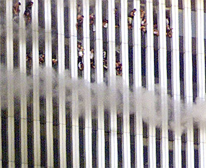 People look out of the burning North tower of the World Trade Center. Shortly after this photo was taken this tower fell.
