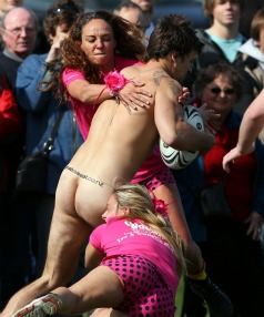 Going in for the tackle - members of the female Spanish rugby players showed total commitment during a game against the Nude Blacks today.