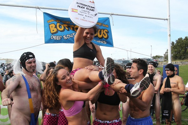 Members of Spains all-girl Los Conquistadors team hold up the trophy for winning the International Nude Rugby match. No-one remembers the score.