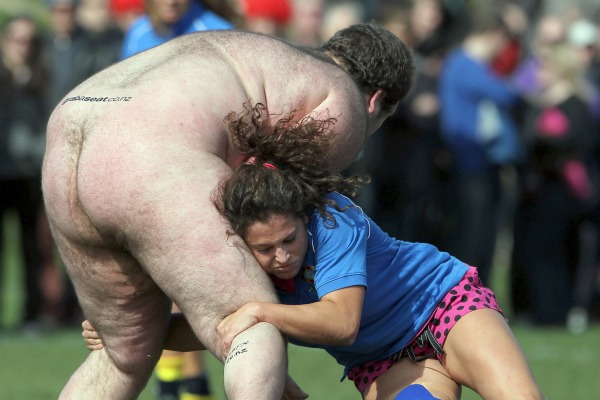 Yes - she was probably wise to keep her eyes closed. A member of the all-female Spanish rugby team goes in for a hairy tackle during a game against the Nude Blacks in Dunedin today.