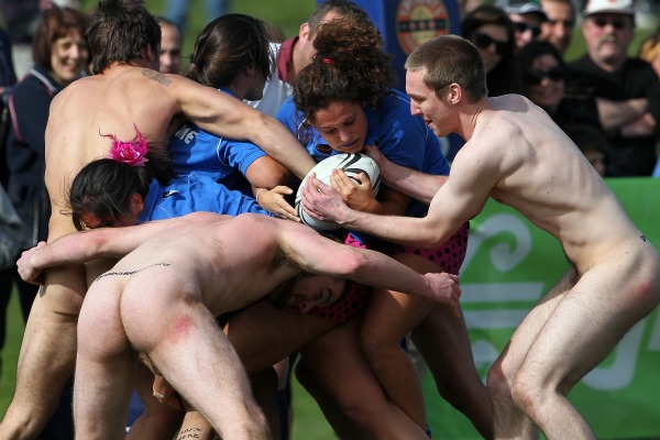 Members of the Spanish all-girl's team Los Conquistadors clash with the Nude Black team during the International Nude rugby game against the Nude Blacks in Dunedin.