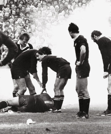 NOT DONE AND DUSTED: All Blacks prop Gary Knight felled by a flour bomb, dropped from a Cessna piloted by Marx Jones.