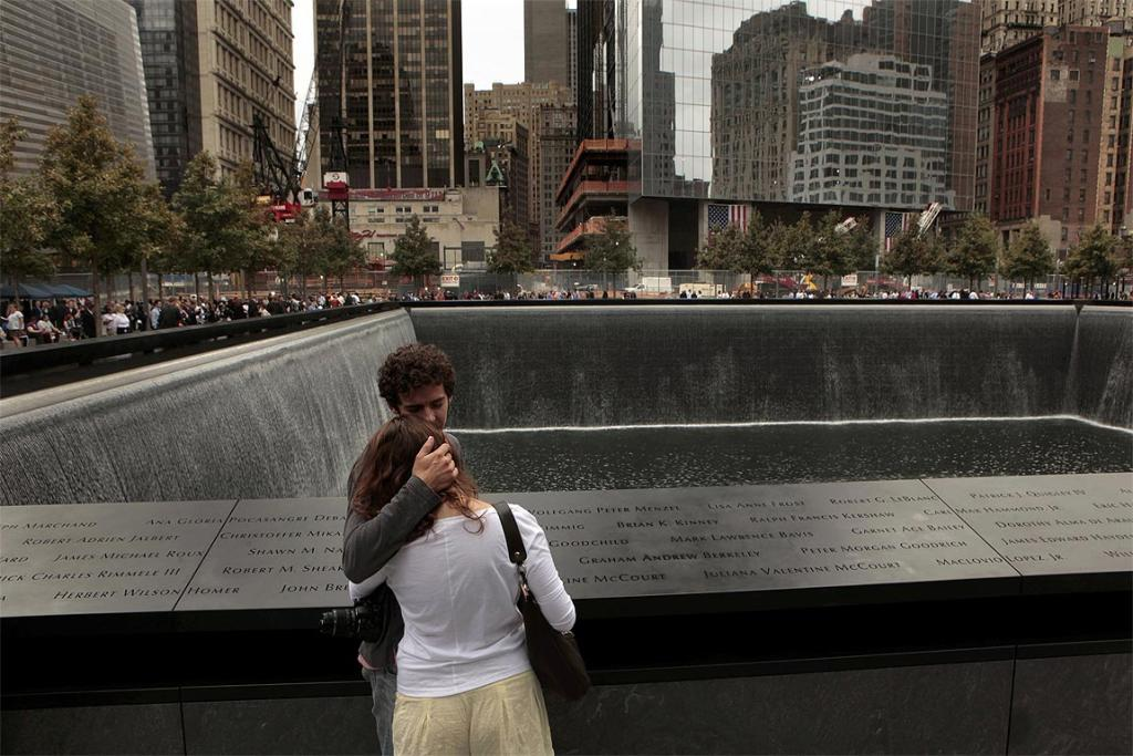 Daniel Jones, who lost his brother, Christopher Carstenjen, holds Rebecca Moss at the site of his brother's name on the 9/11 Memorial during tenth anniversary ceremonies at the World Trade Center site in New York.