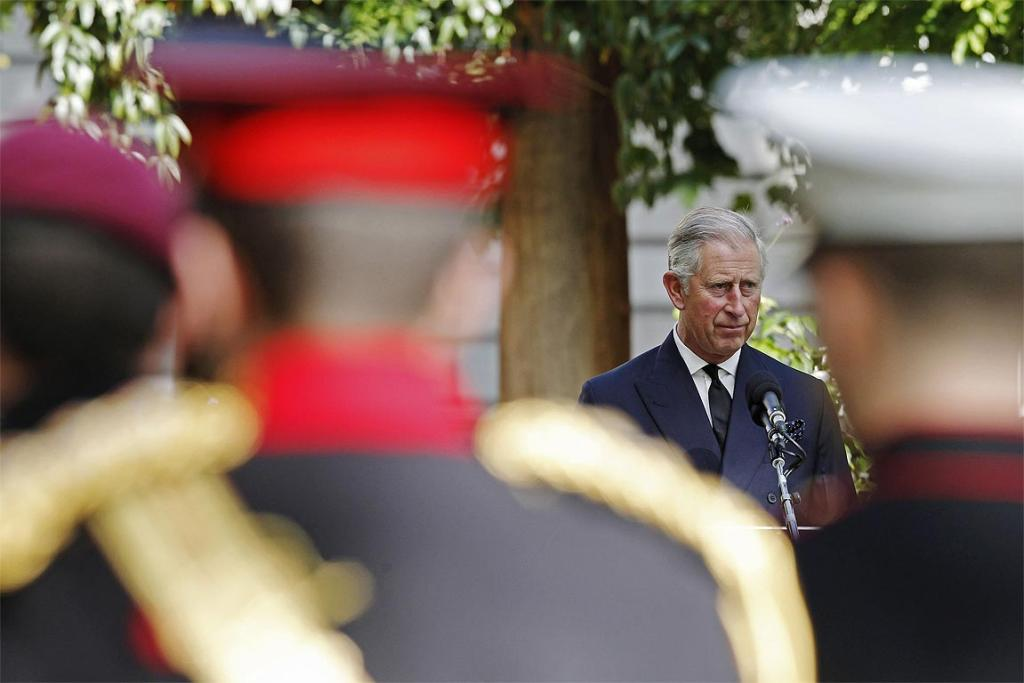 Britain's Prince Charles addresses friends and family of victims of the 9/11 attacks on the World Trade Center in New York during the 10th anniversary ceremony at the memorial near the US Embassy in London.
