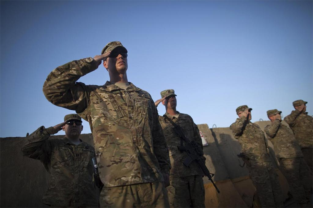 US soldiers salute during a memorial ceremony to commemorate the 10th anniversary of the 9/11 attacks, at Bagram airbase, north of Kabul, Afghanistan.