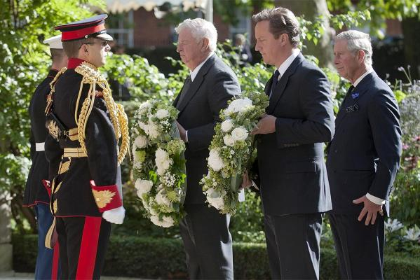 Prince Charles, Prime Minister David Cameron and US Ambassador Louis Susman lay wreaths during a ceremony to commemorate the 9/11 attacks at the memorial near to the US Embassy in London.