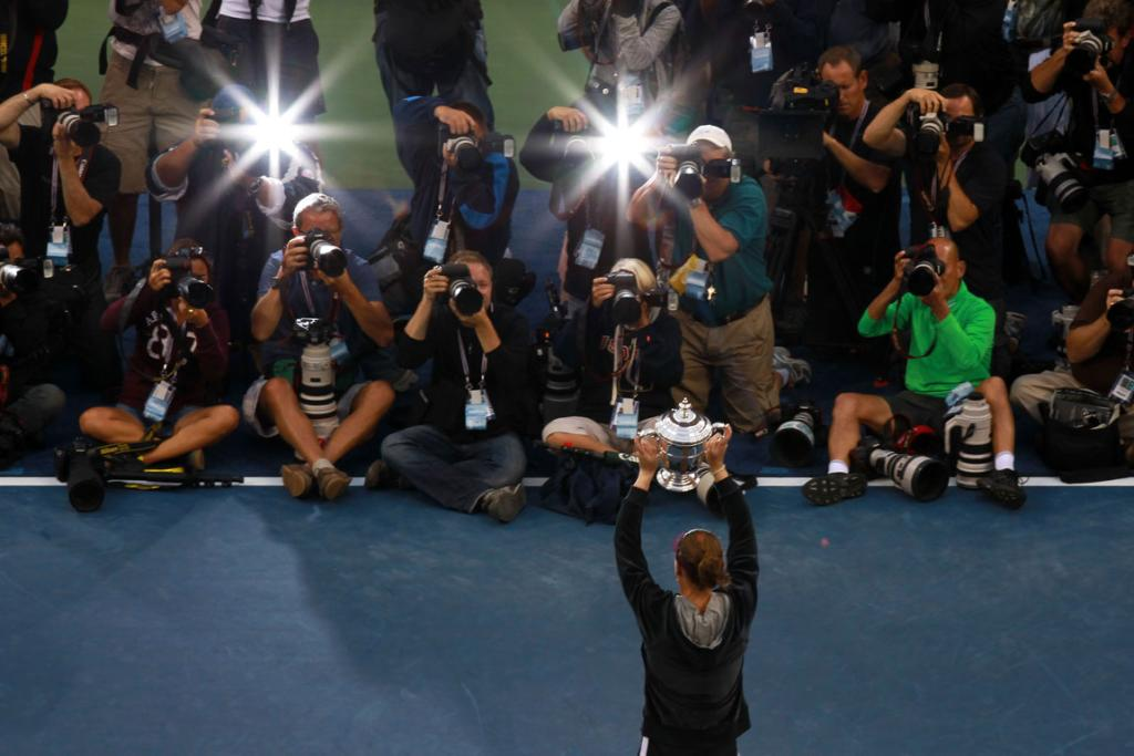 Samantha Stosur is embraced by the world media after winning the US Open women's singles final.