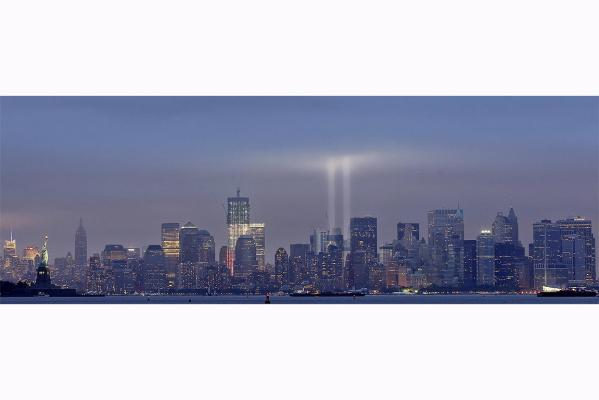 The Tribute in Lights is illuminated on the skyline of lower Manhattan at dusk during events marking the 10th anniversary of the 9/11 attacks on the World Trade Center in New York.
