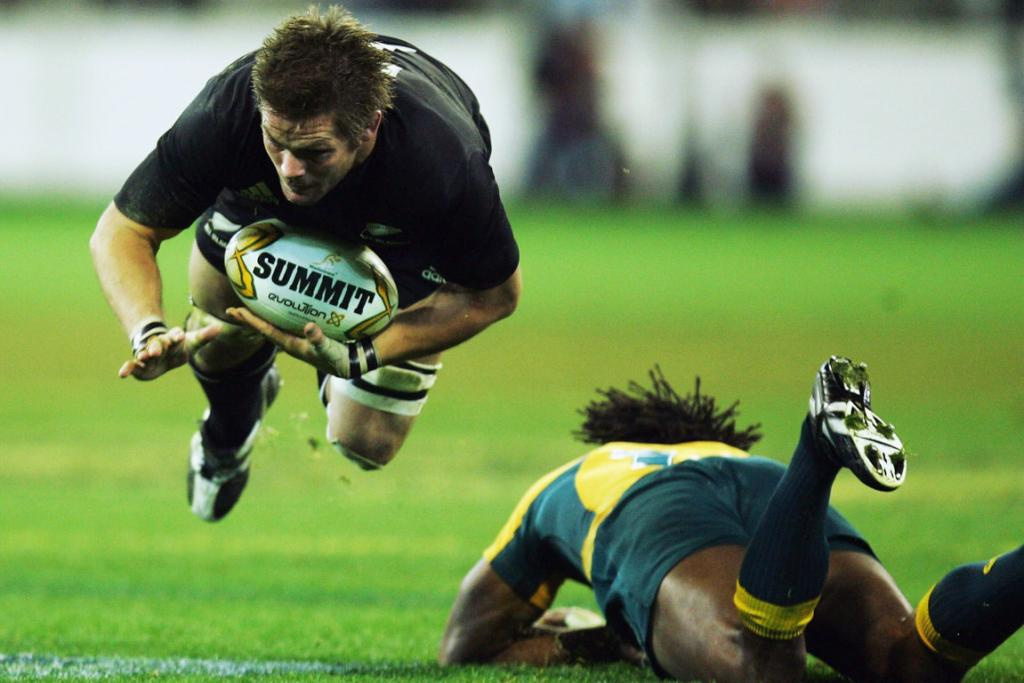 Richie McCaw is tackled by Lote Tuqiri of the Wallabies during their 2007 Tri-Nations match.