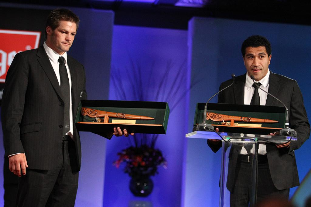 RECOGNISED: All Blacks captain Richie McCaw (left) listens as teammate Mils Muliaina talks after the pair were recognised for setting a New Zealand test caps record on the recent Northern Hemisphere tour.