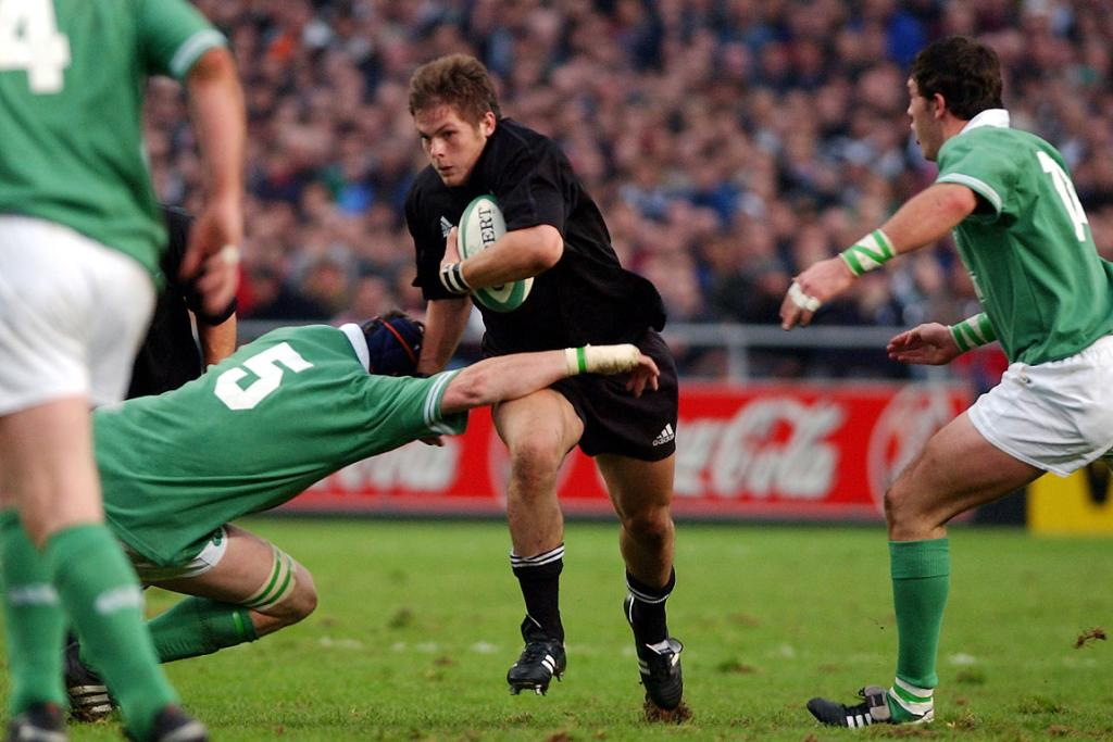 Richard McCaw, on debut for the All Blacks in 2001, runs at the defence against Ireland at Lansdowne Road.