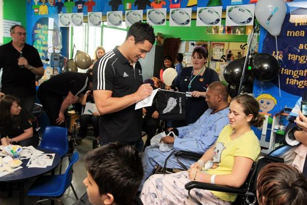 Dan Carter, Corey Flynn and Zac Guildford brought smiles to pained wee faces when they chatted with children and the occasional unwell adult, but the number of television crew, reporters and photographers was overwhelming for some patients.
