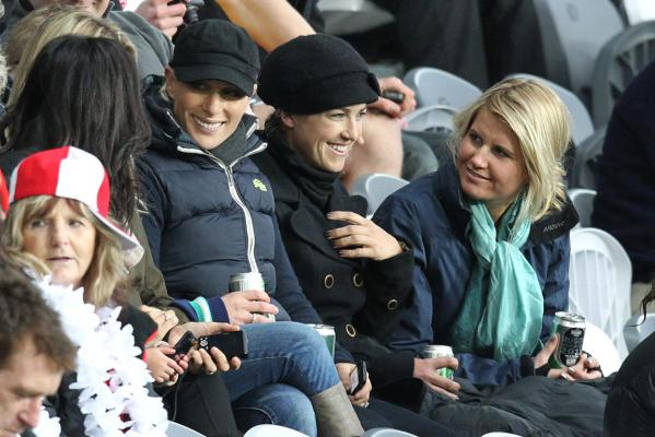 Queen Elizabeth's grand-daughter Zara Phillips (black cap)  with her friends at the England-Romania Rugby World Cup match in Dunedin.