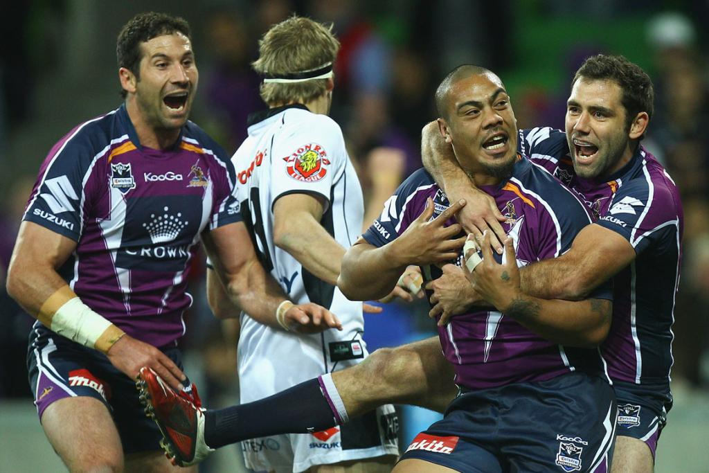 Sika Manu is congratulated by teammate Cameron Smith after scoring a try for the Melbourne Storm.