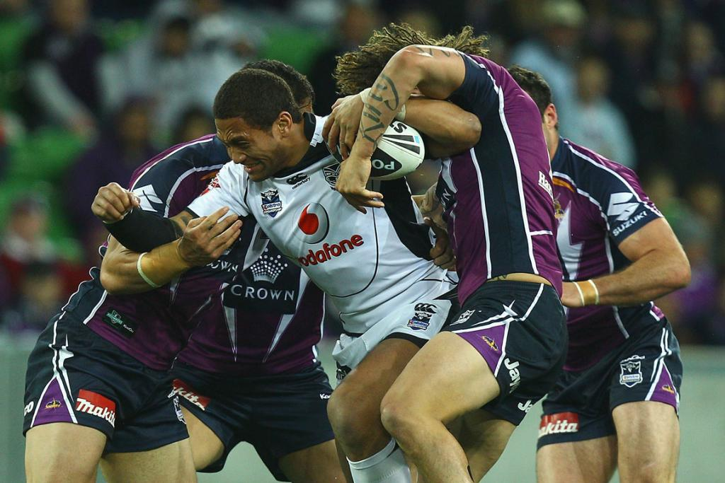 Warriors winger Manu Vatuvei takes on the Melbourne defence.