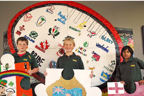 Rugby memories: South Wellington Intermediate pupils Cole Robinson, Tom Lockwood-Jones and Shae Patel show off their artwork.