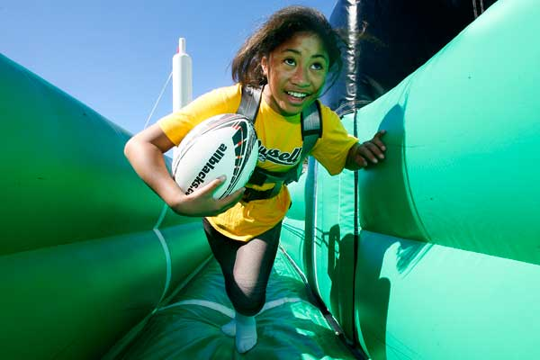 FAN FUN: Kristina Uilao on the bungy ride at the Backing Black fan day at Waitangi park, Wellington.