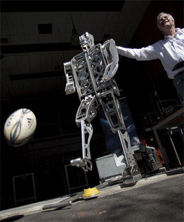 PUTTING THE BOOT IN: Massey University senior lecturer Rory Flemmer with the rugby ball-kicking robot.
