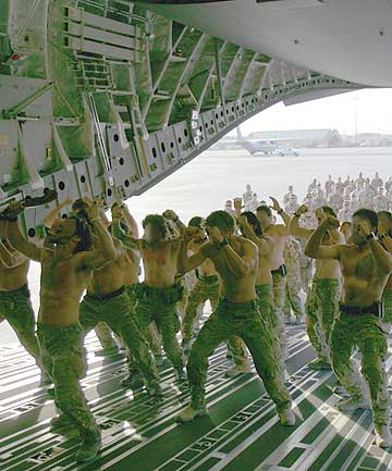 FIERCE FAREWELL: Comrades of fallen soldier Leon Smith perform a haka on the ramp of the plane.