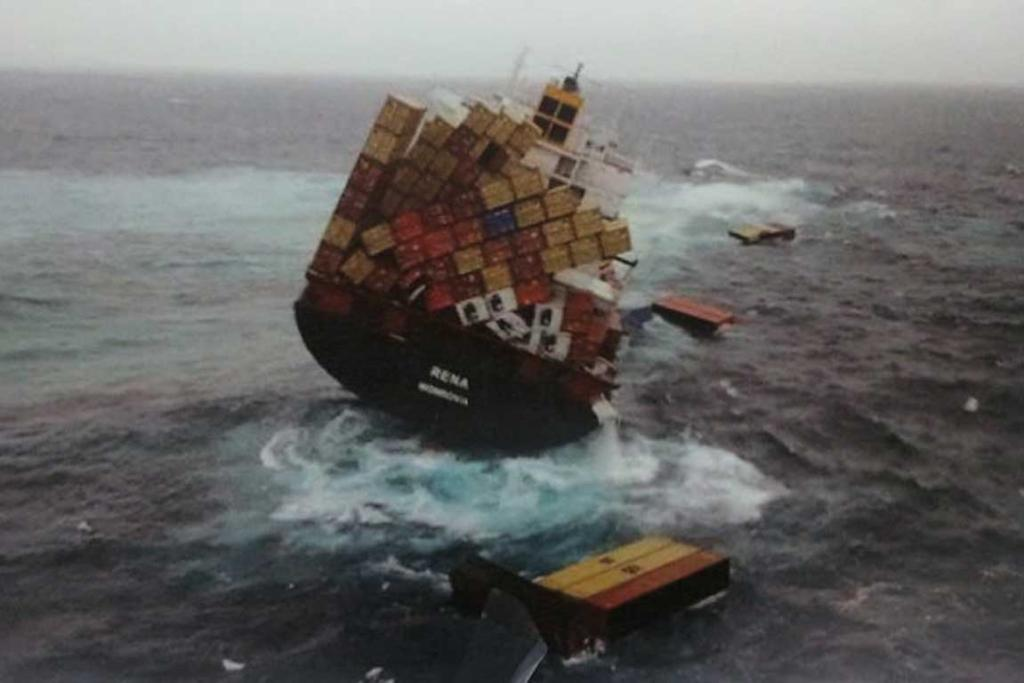 Many containers on the Rena's top deck are tipped on a heavy angle, close to toppling off.