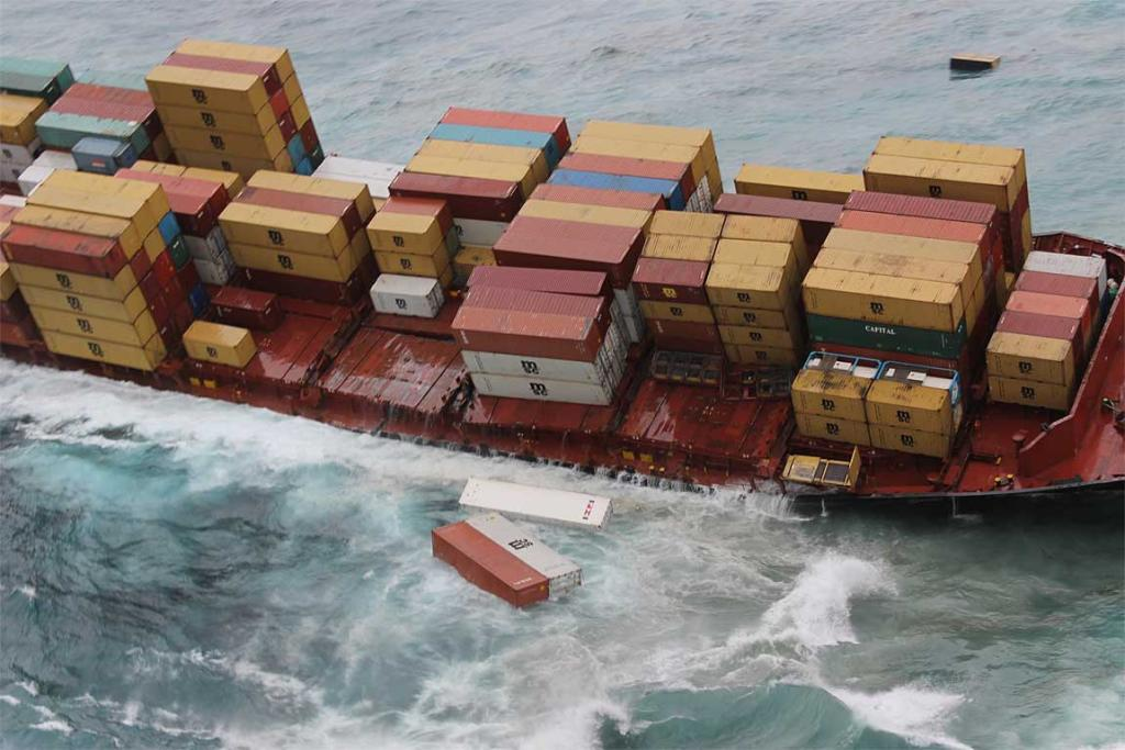 Rena losing containers as heavy swells wash across the ship's deck on the starboard side.