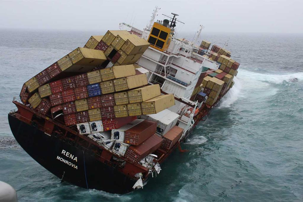Containers have also been crushed as heavy swells wash across Rena's deck.
