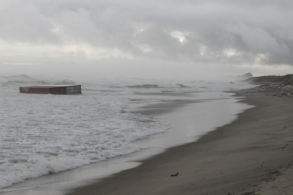 The bleak scene as containers wash up on Mt Maunganui beach.