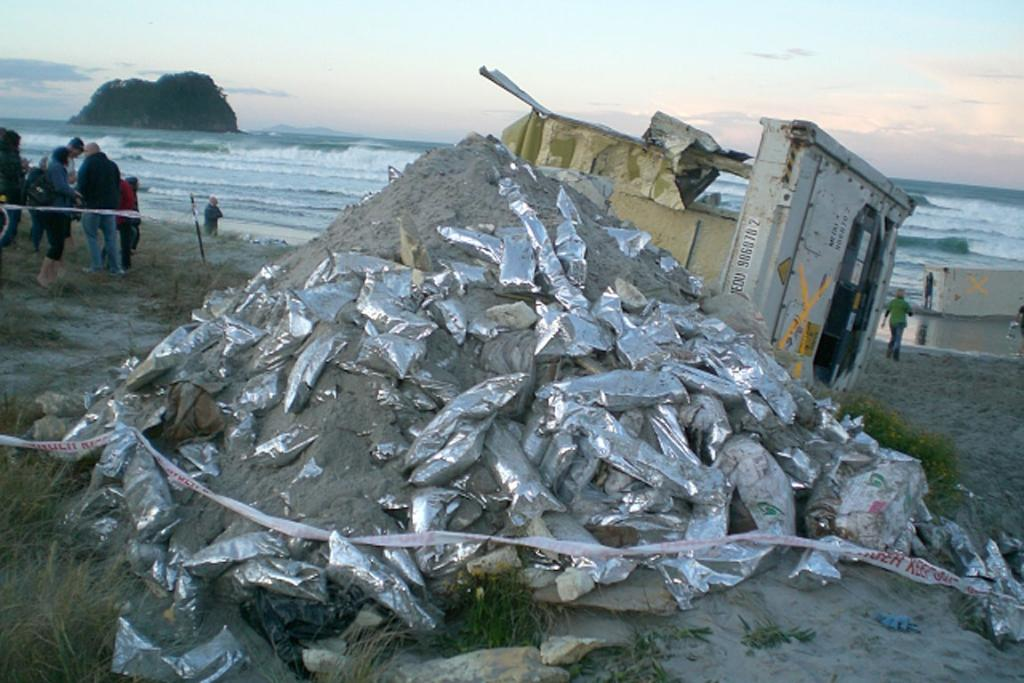 PULLED ASHORE: One of the Rena's broken containers which washed up on Mt Maunganui beach. Pictured Friday, October 14.