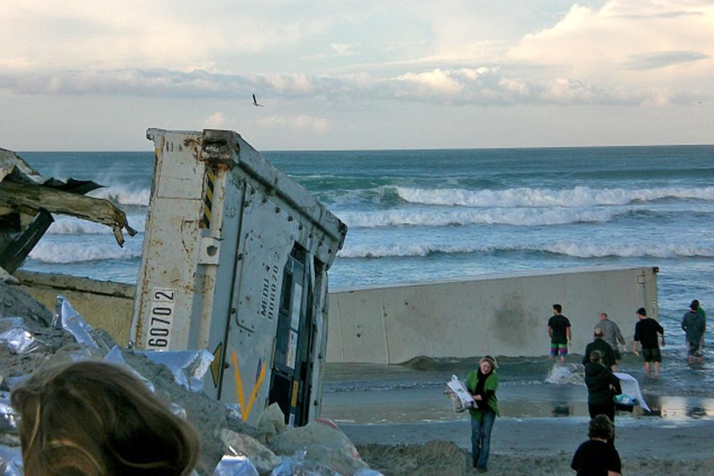 SALVAGE:Containers sit in the water on Mt Maunganui beach. Pictured Friday, October 14.