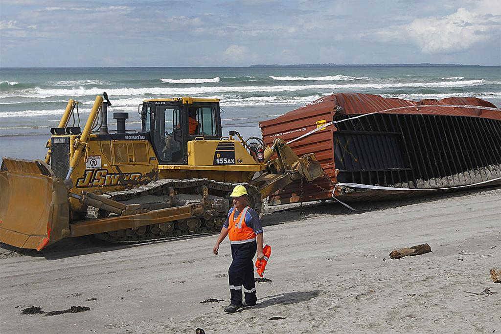 ON THE MOVE: A container is hauled off the beach.