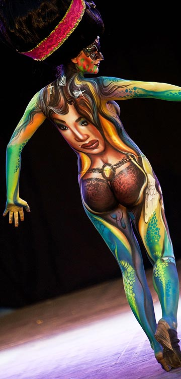 A painted model poses for photographers on the final day at the 2011 World Bodypainting Festival in Austria.