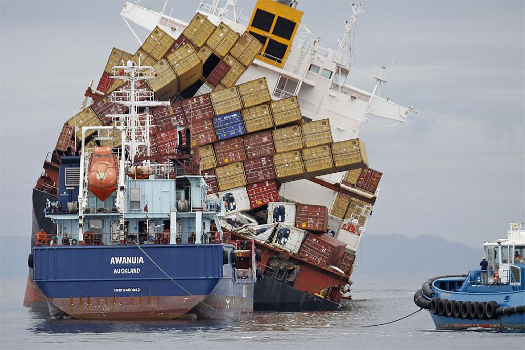 HANGING IN THERE: The Awanuia sits behind the Rena and its leaning stack of containers.