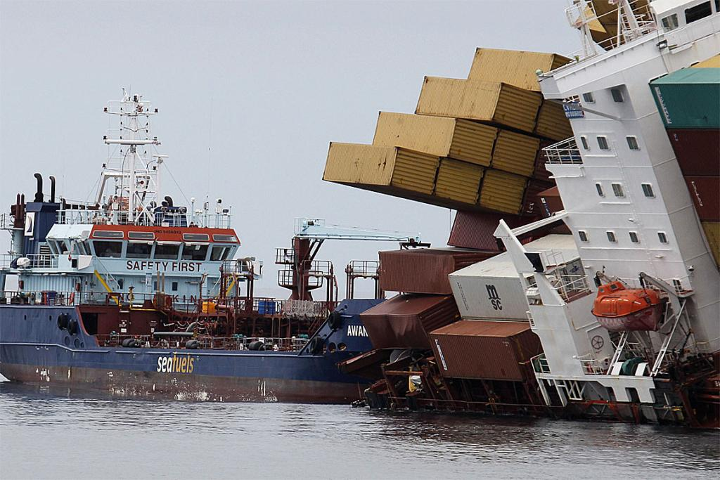HEAVY LIST: Rena's cargo sits precariously on the deck of the ship.