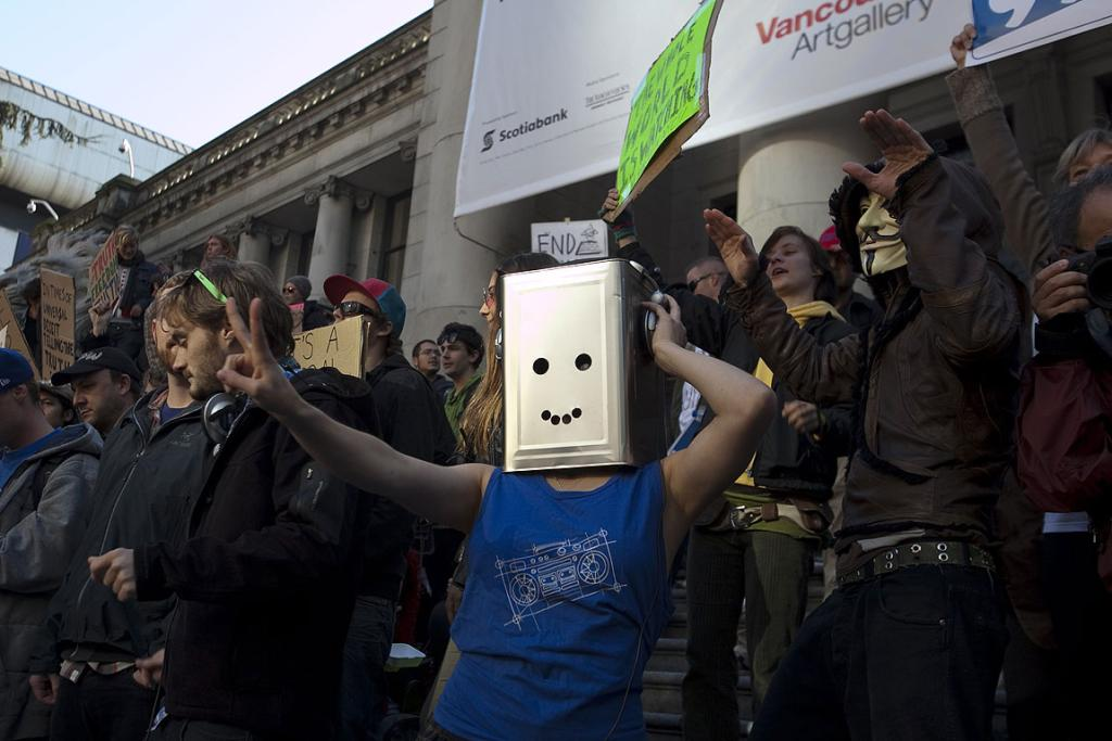 Demonstrators dance on the steps of the Vancouver Art Gallery during the Occupy Vancouver Protest.