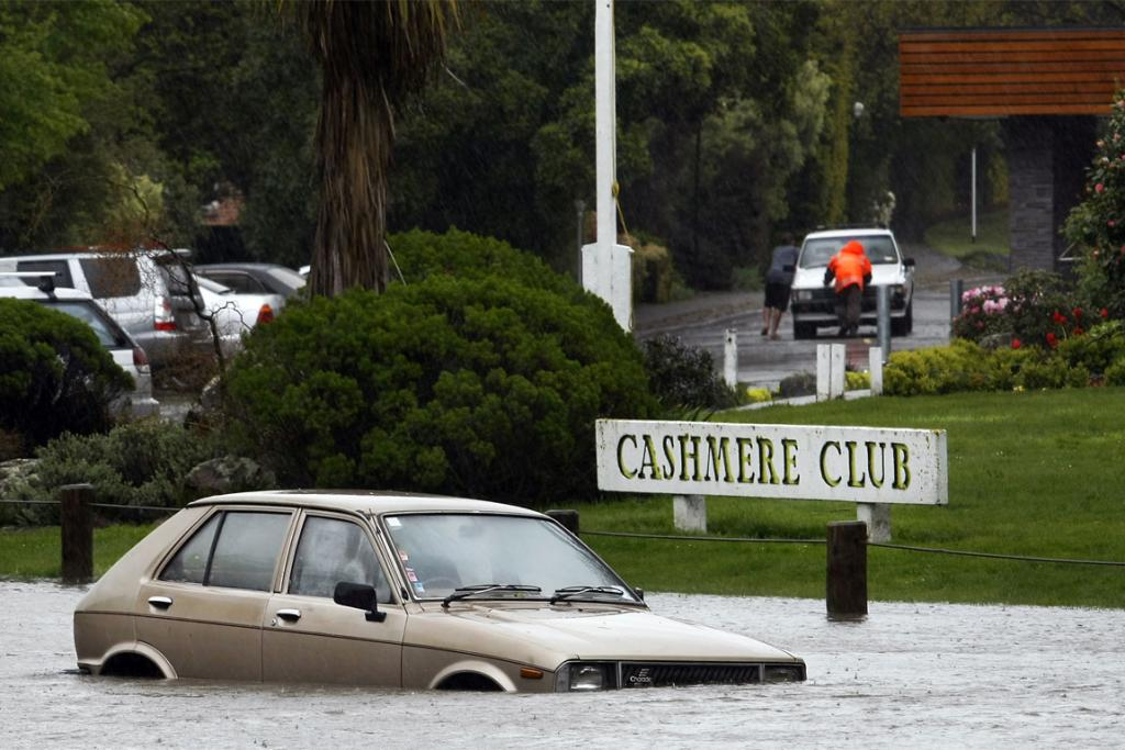 GOING NOWHERE: A car caught in flooding from the Heathcote River. The river burst its banks spilling into Hunter Tce outside the Cashmere Club.