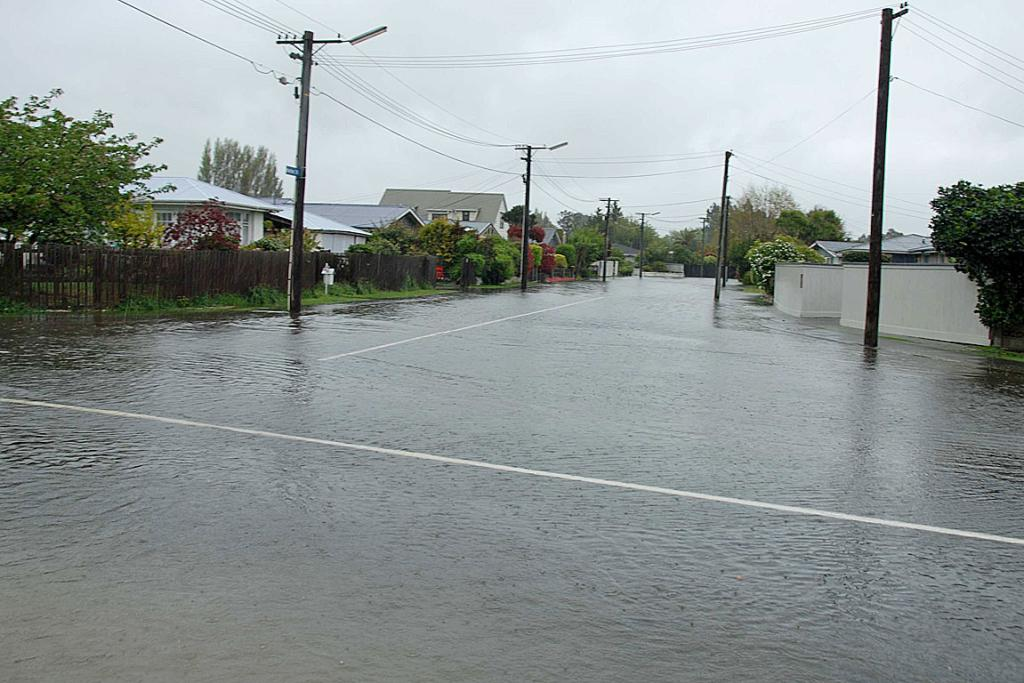 H2O COVER: Water swamps Gainsborough St in Hoon Hay, Christchurch.