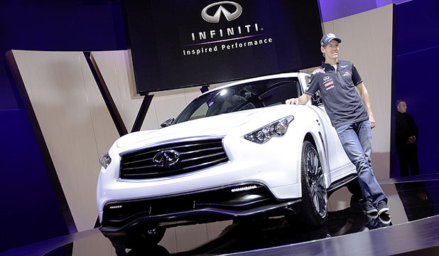 World Formula One champion stands alongside the Infiniti SUV concept at the Frankfurt Auto Show.