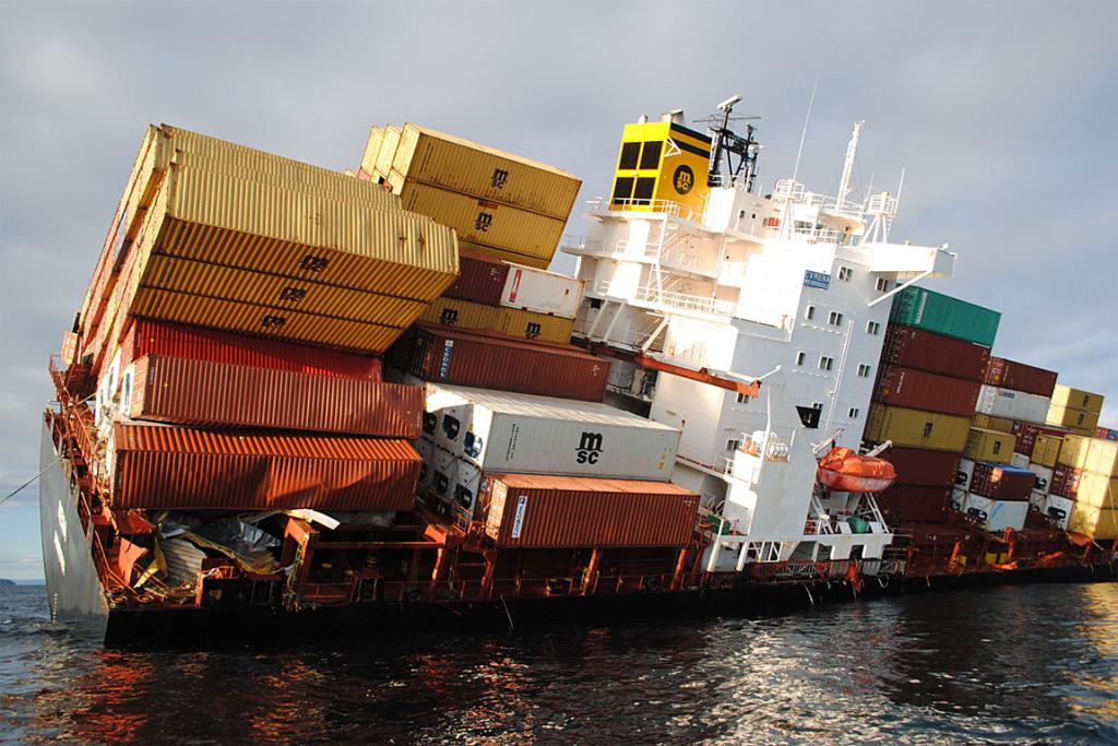 Rena's remaining containers hang precariously. More than 80 containers have fallen overboard. Many have come ashore, and others are being located on the seabed.