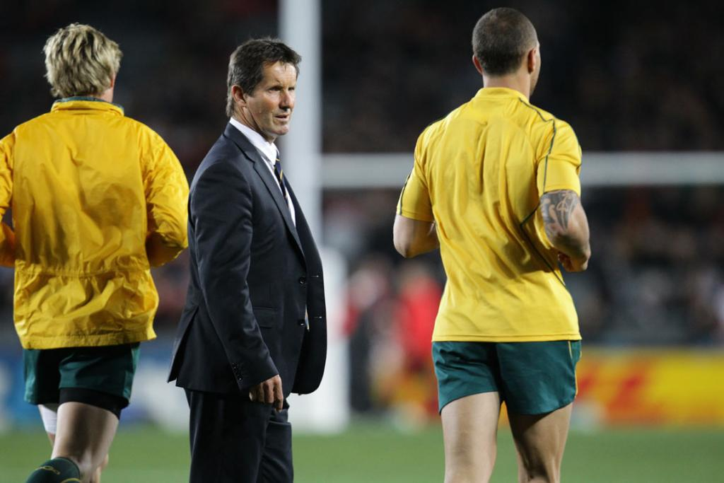 Australian coach Robbie Deans checks out the field before kickoff.